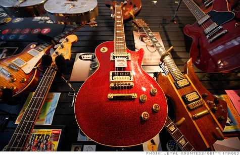 Gibson Guitar has settled with federal authorities for illegally importing ebony and rosewood from India and Madagascar.