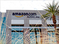 Under siege, Amazon shifts on taxes