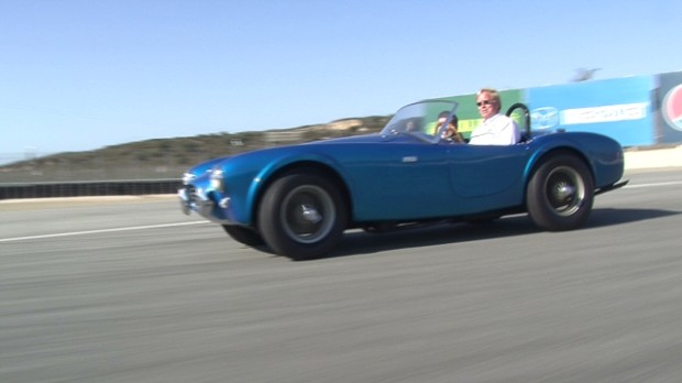 Behind the wheel of the first Shelby Cobra