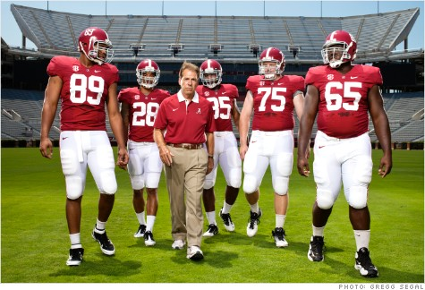 Bryant-Denny Stadium, Tuscaloosa, Ala., Aug. 1, 2012. From left: Michael Williams, Dee Milliner, Coach Saban, Nico Johnson, Barrett Jones, and Chance Warmack
