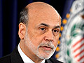 Bernanke warns of fiscal cliff as Fed lowers forecasts