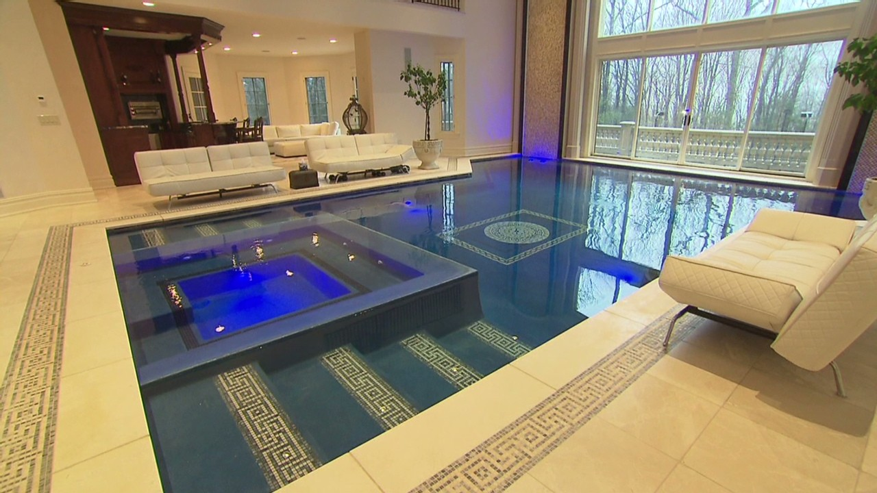 Mansion for sale swim in your living room video for Swimming pool room decor