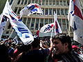 Greece shuts state broadcaster in austerity push