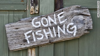 paid time off gone fishing sign