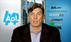 AOL cuts benefits, blames Obamacare