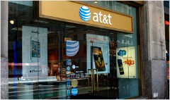 AT&T cuts prices again