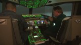 In the cockpit of a Boeing 777 simulator