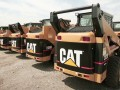 Lousy Caterpillar earnings drag market down