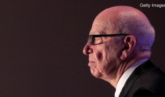 Murdoch says he can't buy Tribune but mum on Time Warner