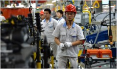 China's factories power ahead to 18-month high