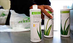 Herbalife stock tumbles on earnings miss