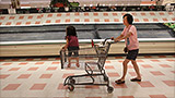 Grocery workers fight for their boss