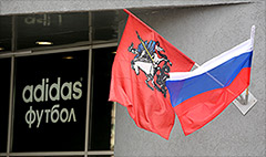 Adidas axes profit forecast over Russia