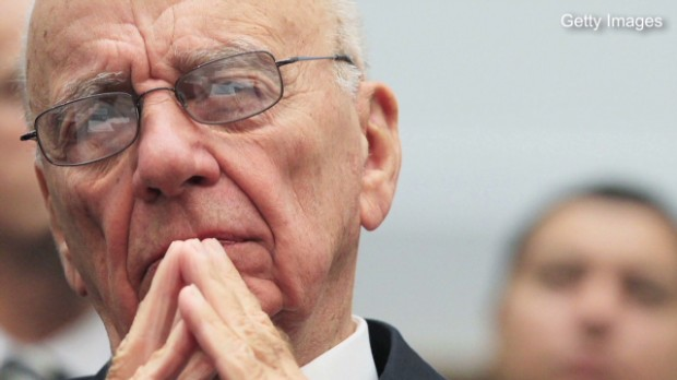 Murdoch backs down from Time Warner bid