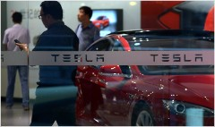 Tesla settles dispute with trademark troll in China