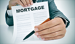 Mortgage rates hit 2014 low