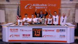 Alibaba surges 40% in huge IPO debut