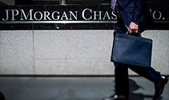 JPMorgan trims legal costs, returns to profit