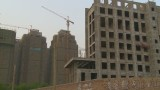 China's economy slows, home prices fall