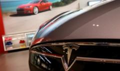 Toyota cuts stake in Tesla