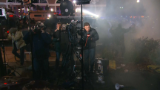 Ferguson reporters hit with tear gas, rocks