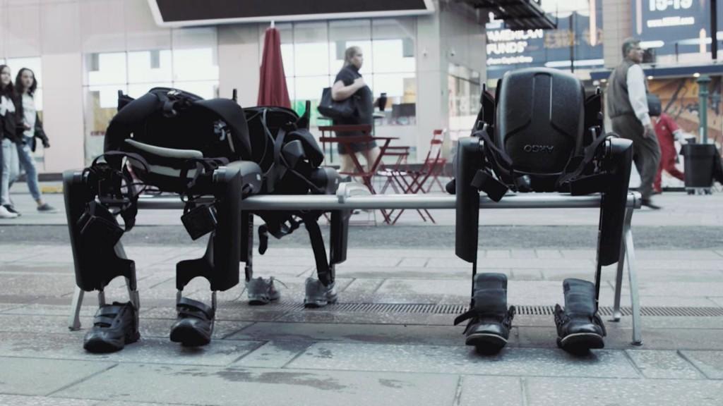 Watch a robot help a paralyzed man walk