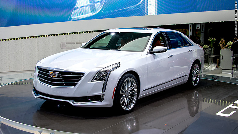 cadillac unveils new plug in hybrid sedan. Black Bedroom Furniture Sets. Home Design Ideas