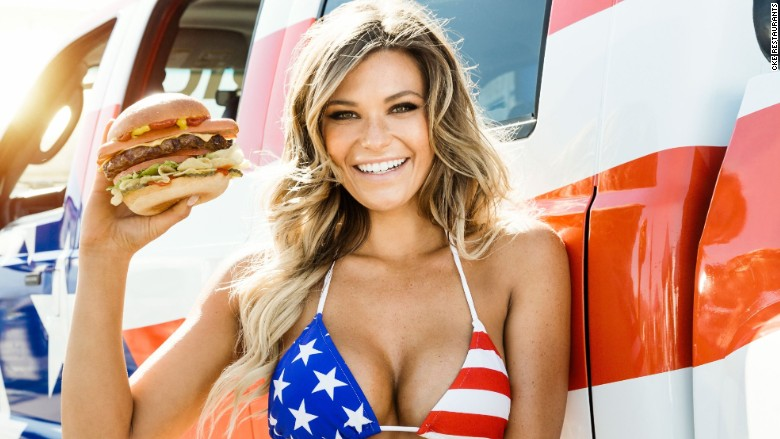 Model in a hot tub on a truck showcase Carl's Jr. new 1,000-calorie burger