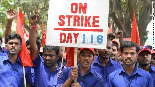 India's workers strike to challenge Modi