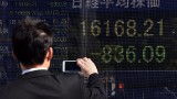 Japan stocks sink as key bond yield goes subzero