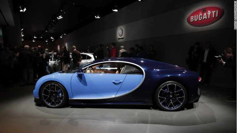 'bugatti chiron geneva side' from the web at 'http://i2.cdn.turner.com/money/dam/assets/160301102618-bugatti-chiron-geneva-side-780x439.jpg'