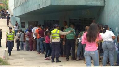 Venezuelans wait on hours-long line for basics