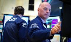 Stocks unruffled by debate; oil down as OPEC meets; Deutsche slides again
