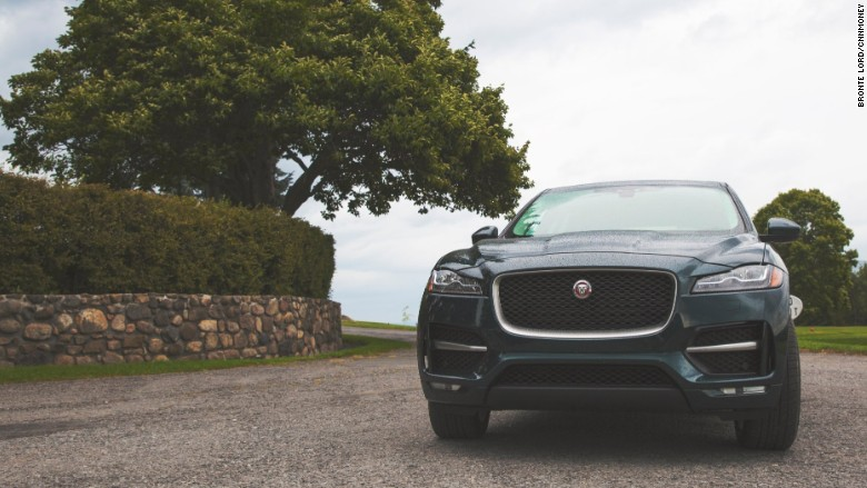2017 jaguar f-pace front with tree