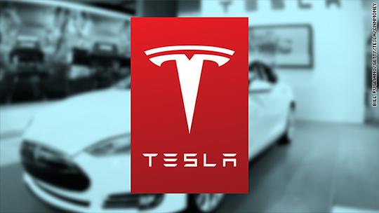 Tesla posts rare profit, stock pops 6%