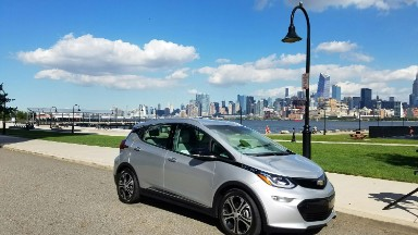 GM delivers its first new electric cars in Tesla's backyard