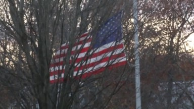 Students lower flag in election protest