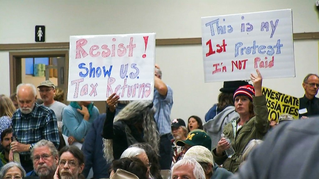 Town halls demand Trump's tax returns