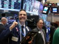 Dow sets first record high since January