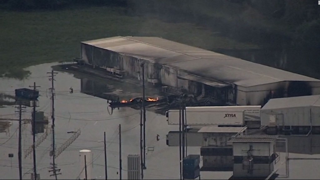 Fire at flooded chemical plant