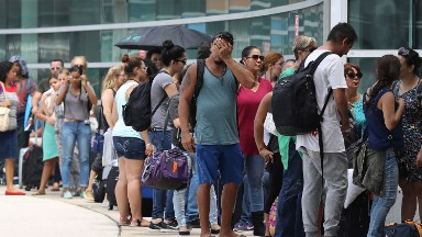 'I don't feel safe here': A night of desperation in San Juan's sweltering airport