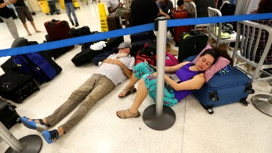 More flights leaving San Juan, but thousands are still stranded
