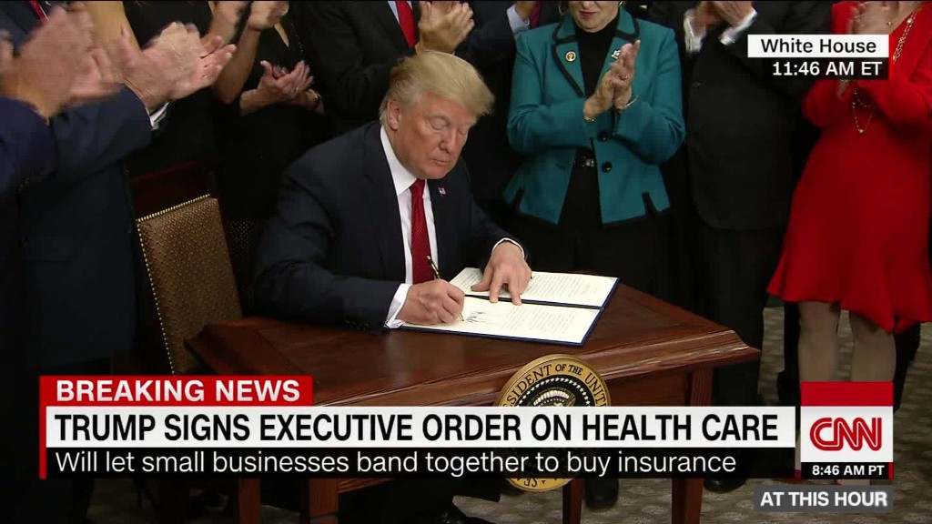 Trump signs health care executive order (after nearly forgetting)