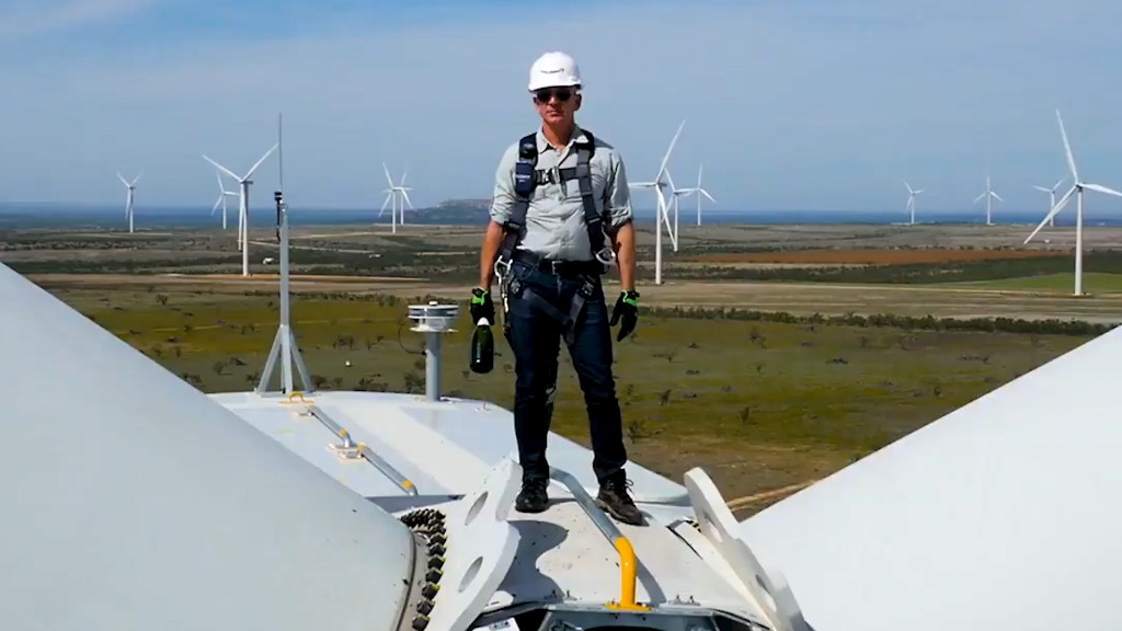 Jeff Bezos smashes bottle on top of wind turbine