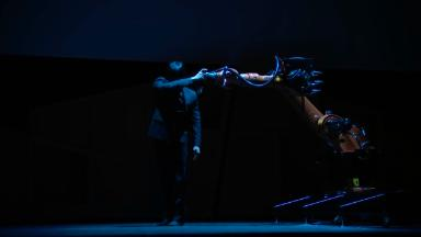 Engineer dances onstage with robot he programmed
