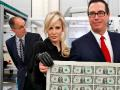 Mnuchin's wife poses with a sheet of money