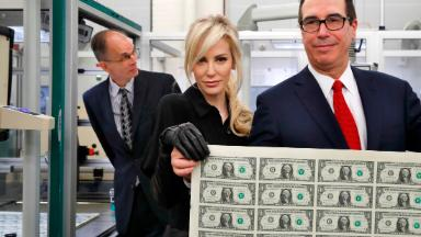 Steven Mnuchin's wife strikes a pose with a sheet of money
