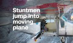 Red Bull stuntmen fly into a plane mid-air