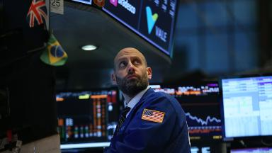 Dow roars back for 567-point gain after scary start