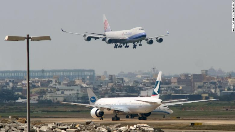 Image result for Airlines cancel more than 200 flights over tensions between China and Taiwan